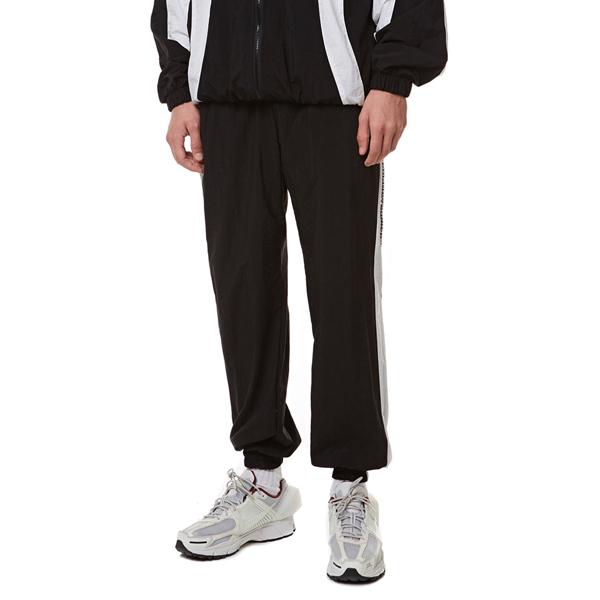 [입점특가]Curve training Zip-up Pants BLACK